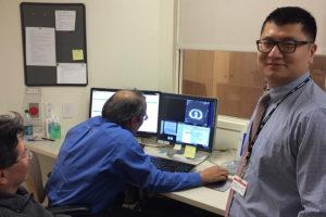 Kaifang Du reviewing 4D CT images with Dinesh Tewatia and Idarto Tan. Late 2015.